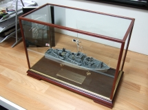 Model Boat behind Glass Showcase