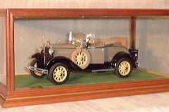 Old Car Displayed in Glass Case