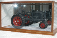 Radcliffe Case displaying model tractor