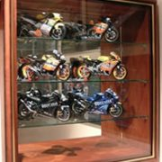 Motorbikes displayed in picture box wall display case